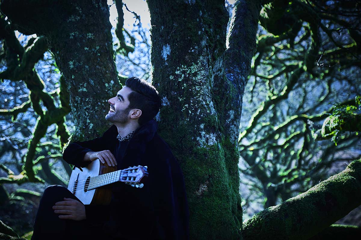 Milos in forest with guitar
